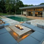 outdoor fire pit beautifully done with heated pool